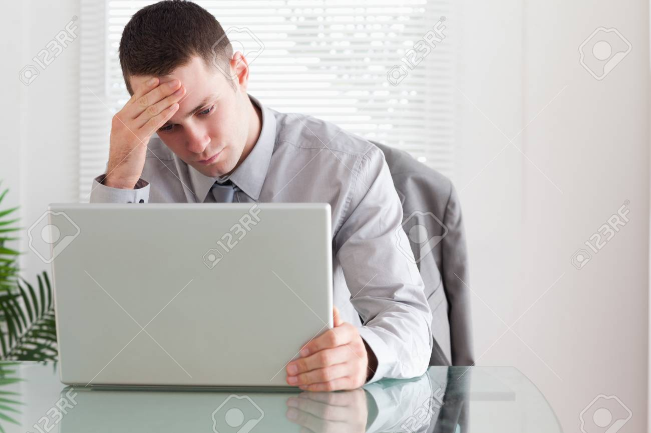 Young businessman looking at his laptop Stock Photo - 11619984