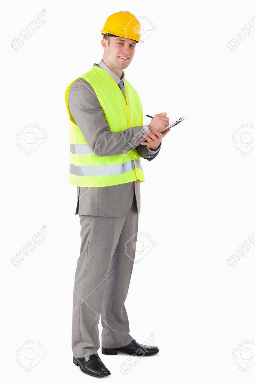 Portrait of a smiling contractor taking notes against a white background Stock Photo - 11618842