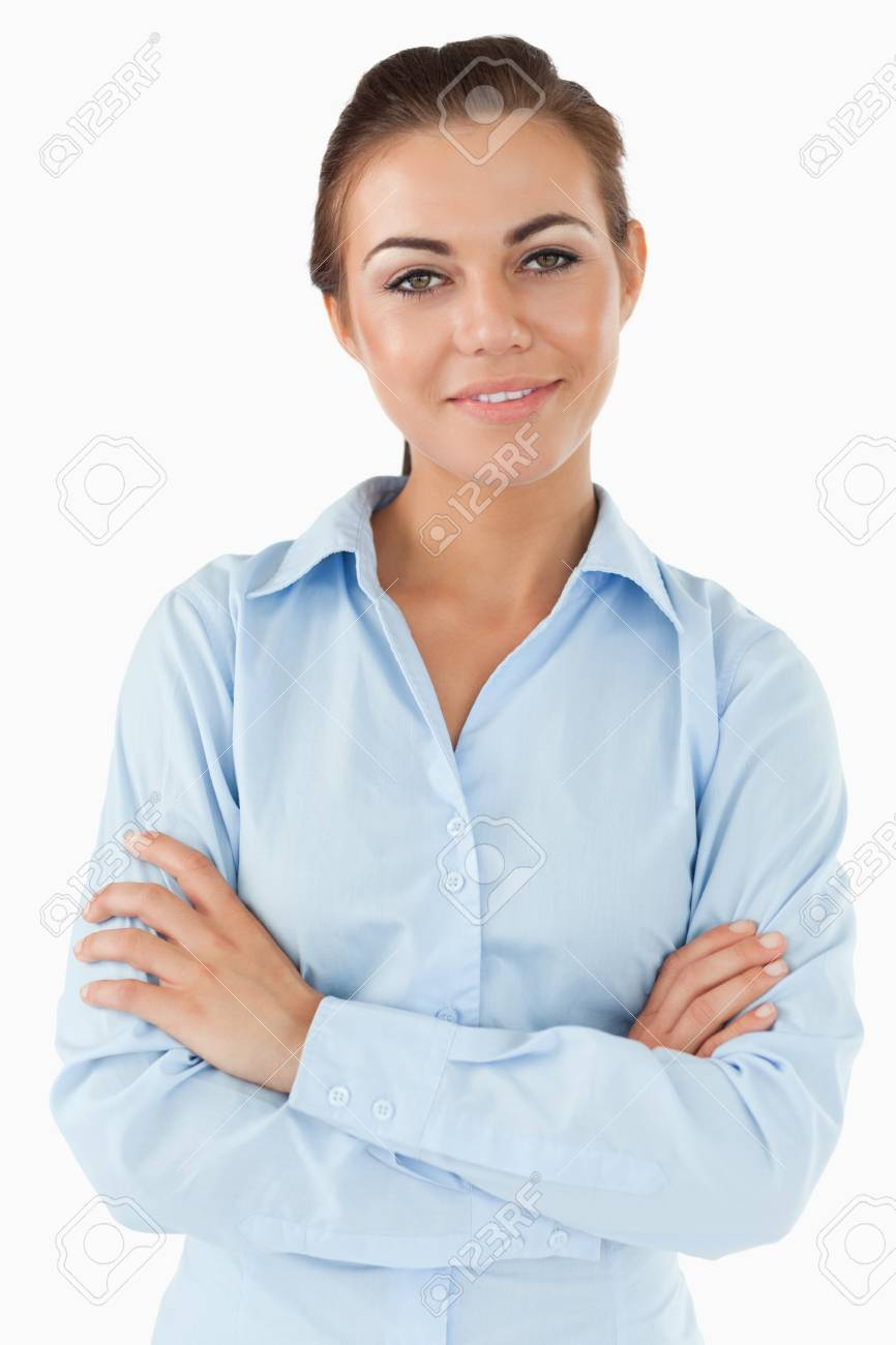 Smiling businesswoman with arms folded against a white background Stock Photo - 11636556