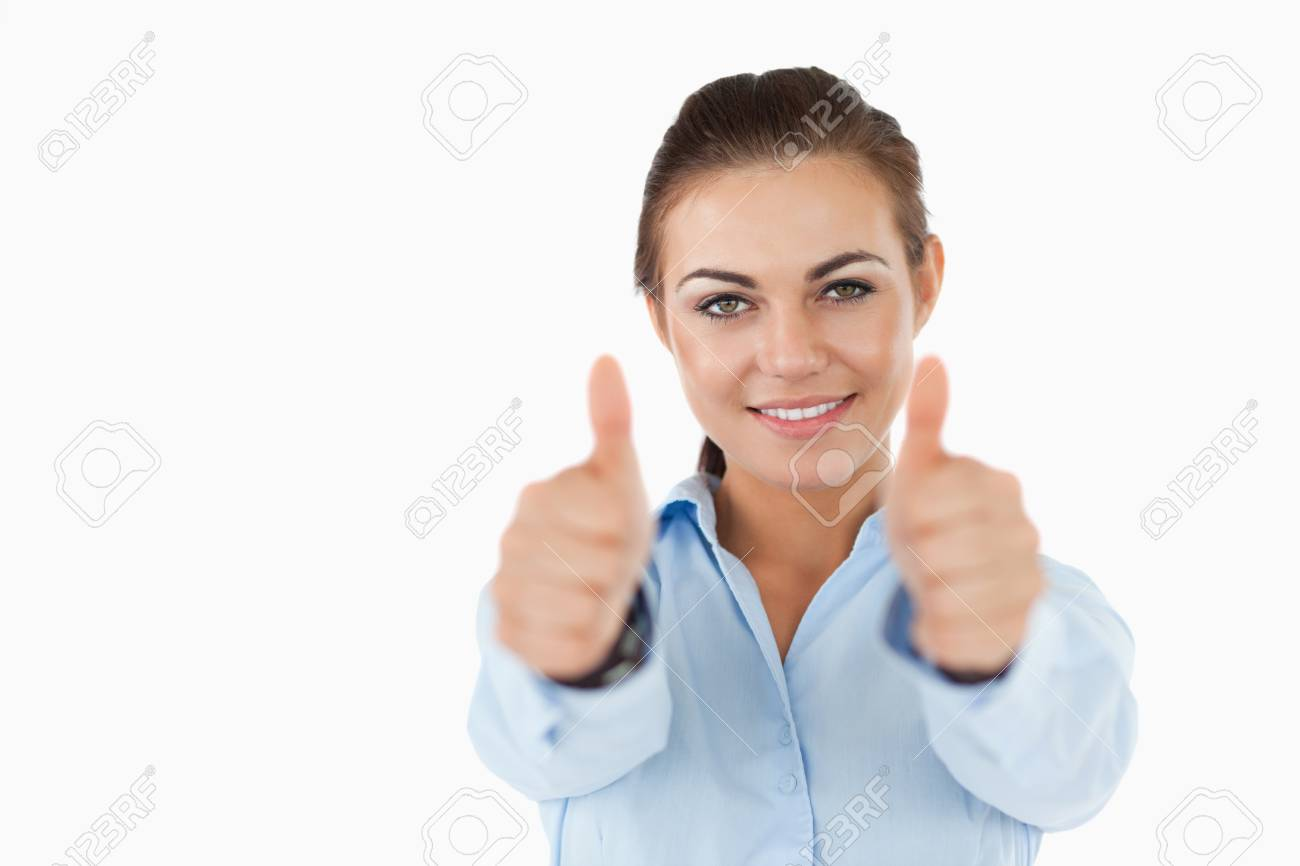 Smiling businesswoman approving against a white background Stock Photo - 11624154