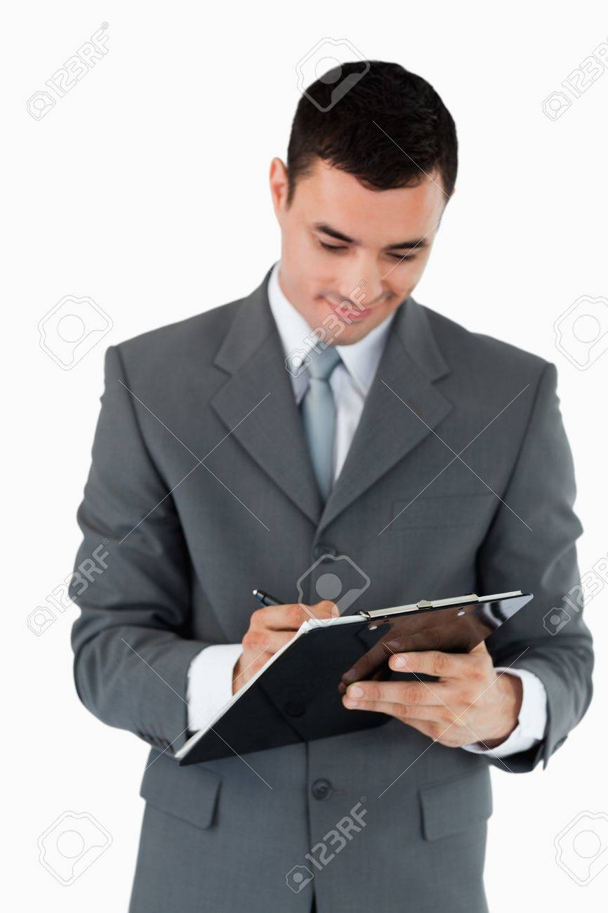 Businessman taking notes on clipboard against a white background Stock Photo - 11635562