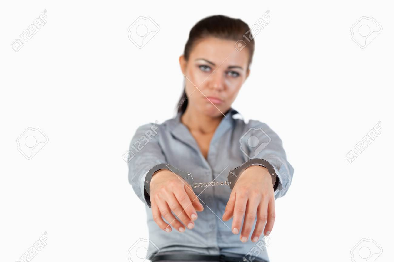 Businesswoman with handcuffs against a white background Stock Photo - 11624407