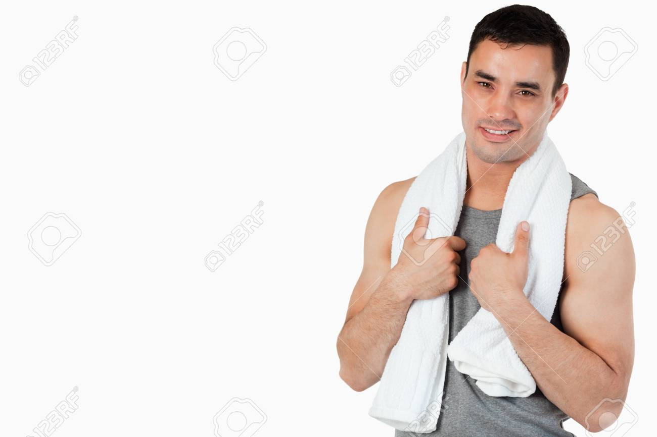 Smiling young male after workout against a white background Stock Photo - 11625061