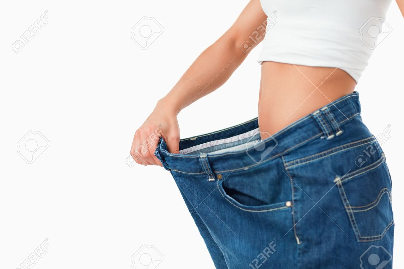 Woman wearing too large pants against a white background Stock Photo - 11636571