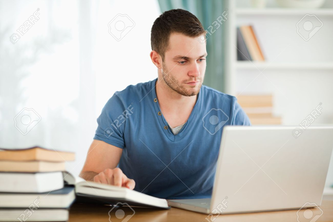male student researching material on the internet stock photo male student researching material on the internet stock photo 11636585