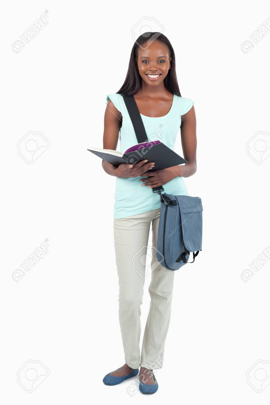 Smiling young student with her book against a white background Stock Photo - 11623910
