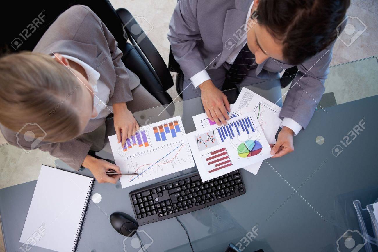 Business team looking at statistics in a meeting room Stock Photo - 11680854