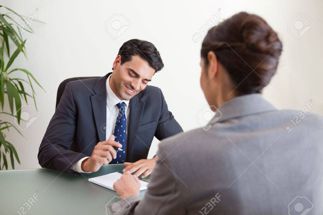 manager interviewing a female applicant in his office stock photo manager interviewing a female applicant in his office stock photo 11684073