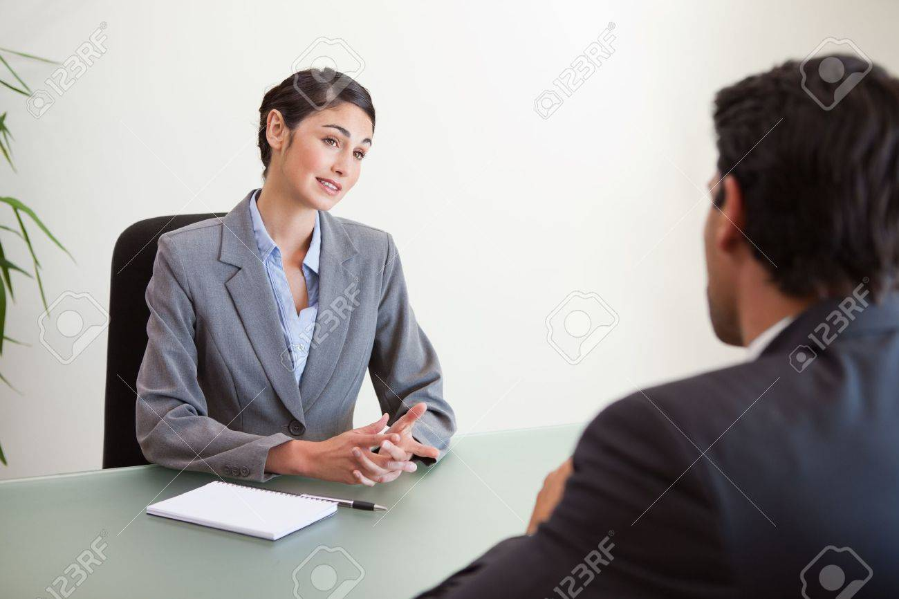 manager interviewing a good looking applicant in her office stock manager interviewing a good looking applicant in her office stock photo 11685205