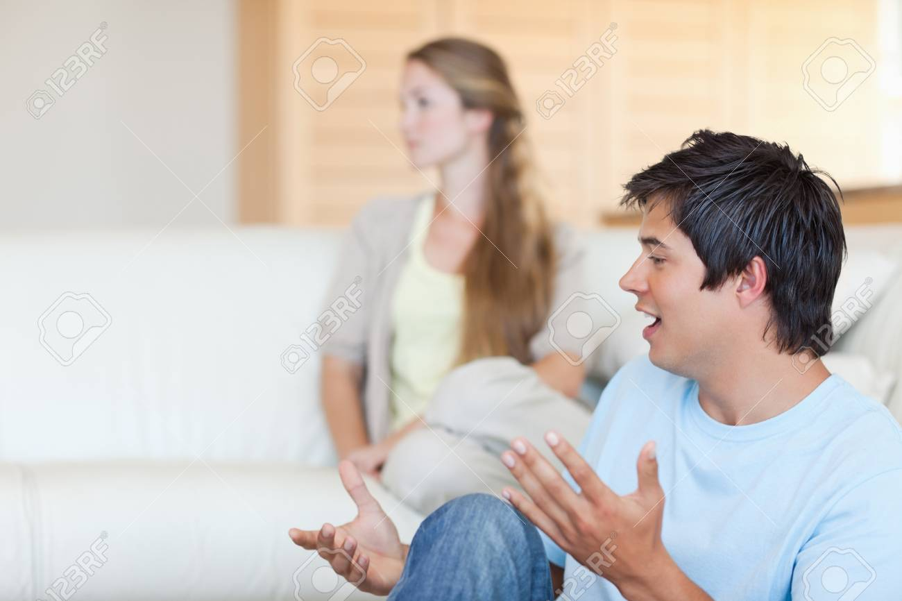 Young couple arguing in their living room Stock Photo - 11685587