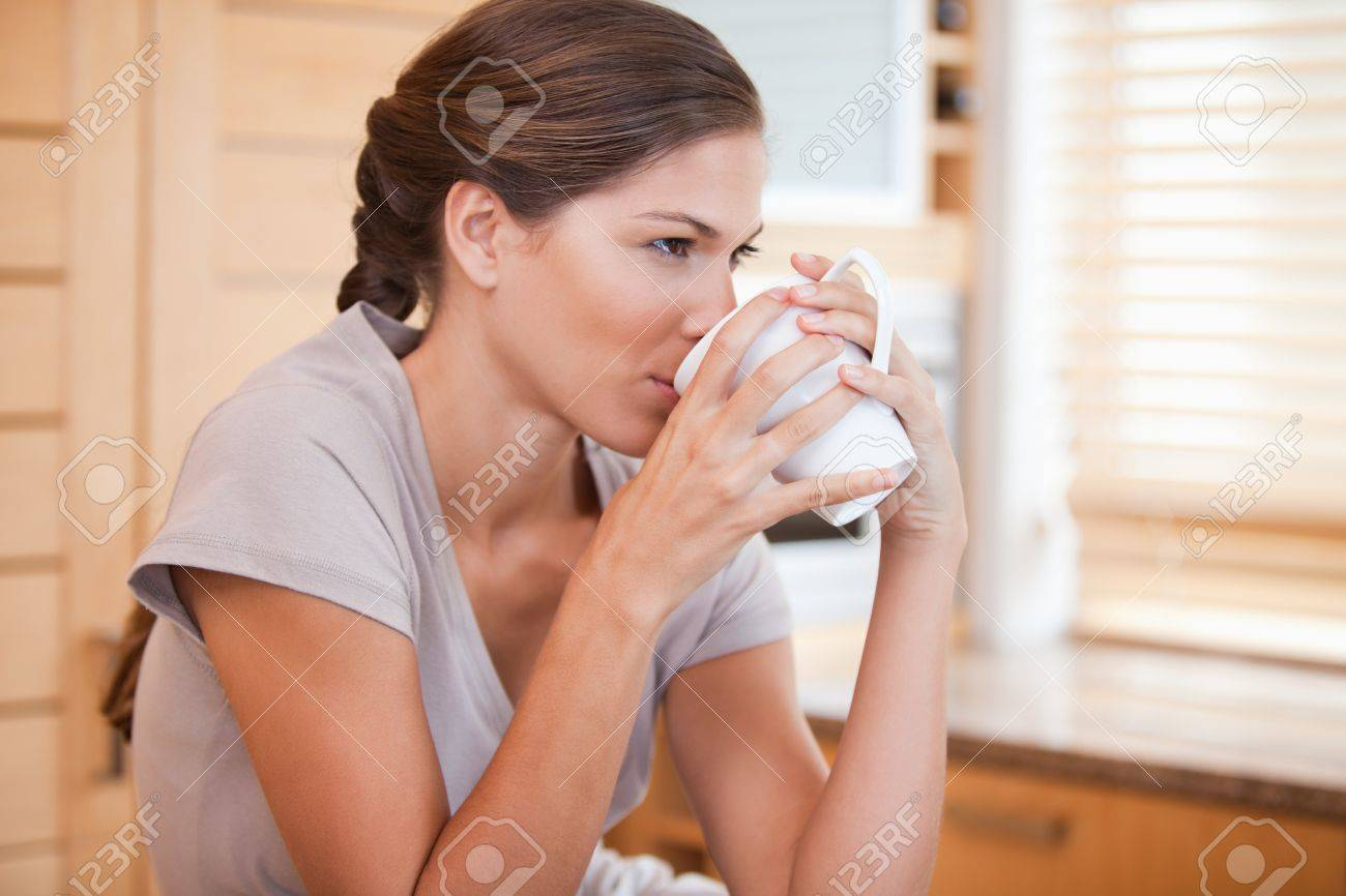 Side view of young woman drinking coffee Stock Photo - 11684184