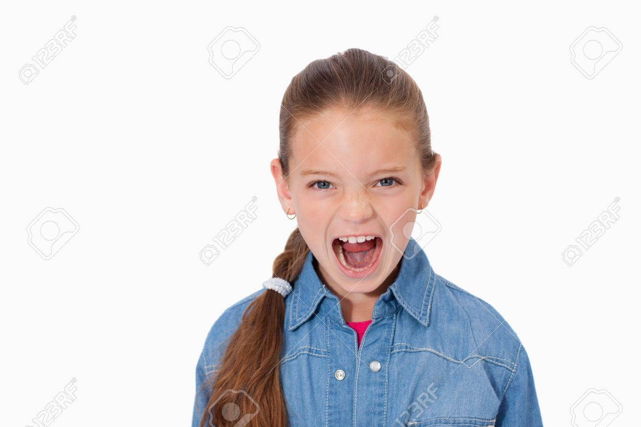 Unhappy girl screaming against a white background Stock Photo - 11687060