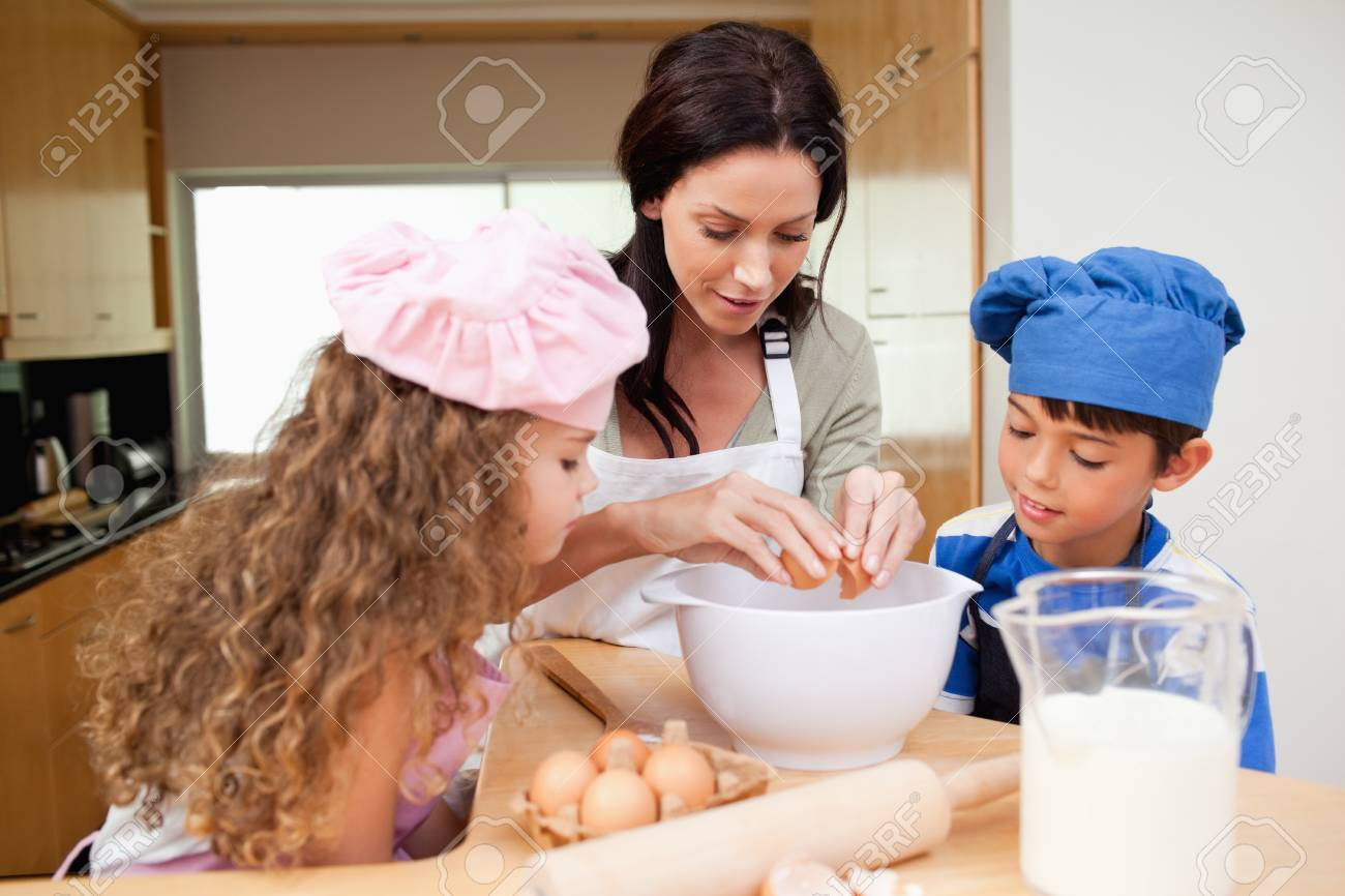 Mother making cookies together with her kids Stock Photo - 11682890