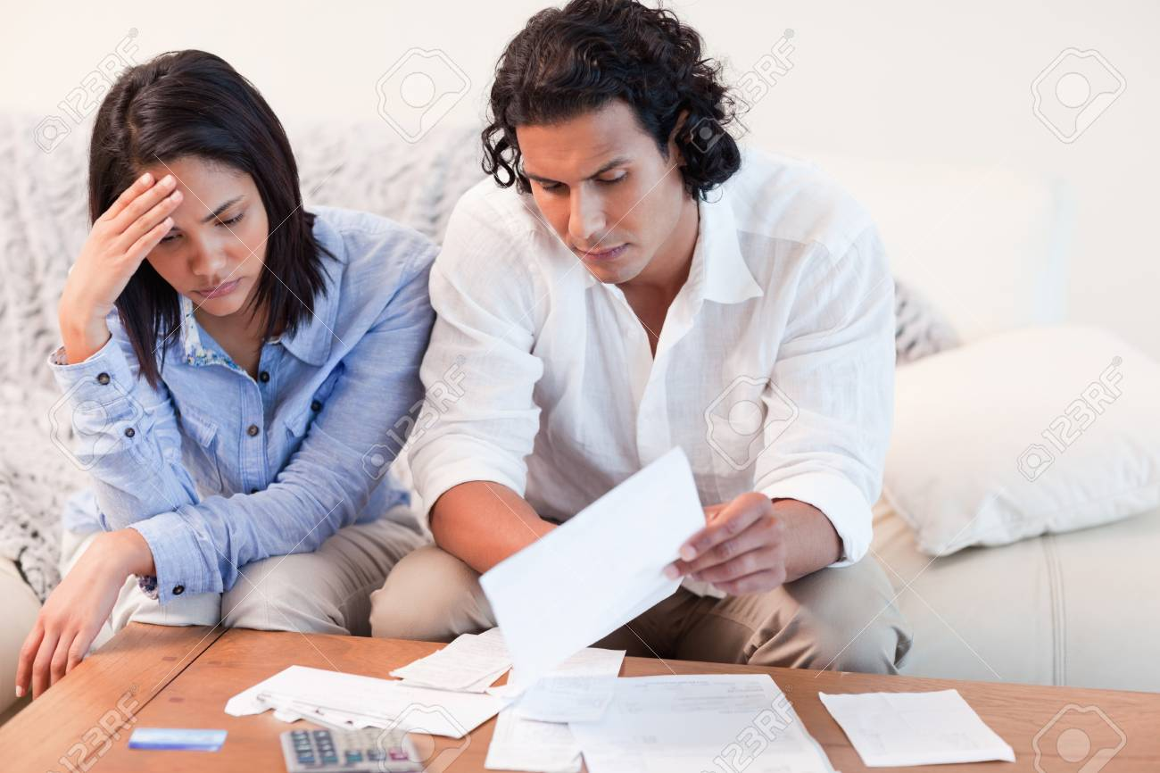 Young couple depressed about financial problems Stock Photo - 11684227