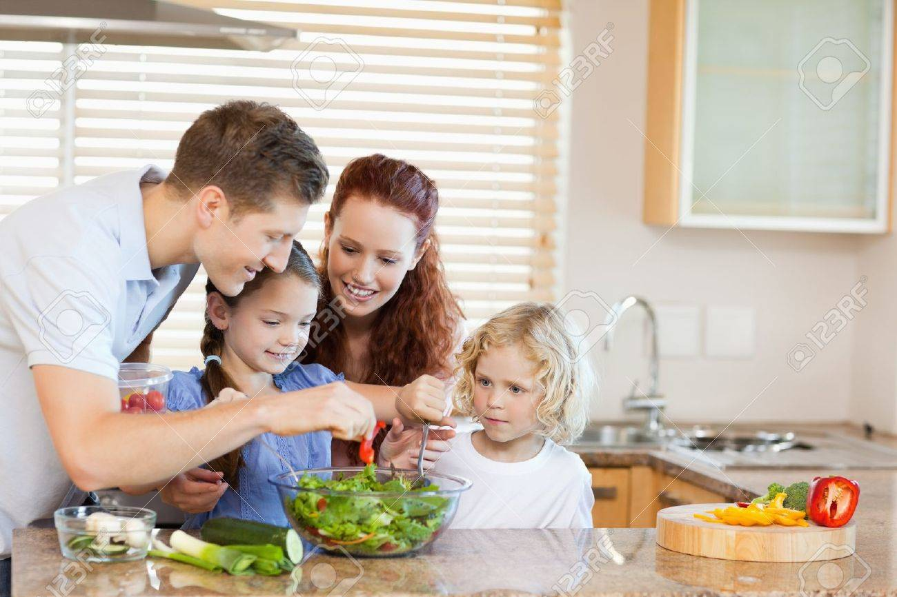 Young family preparing salad together Stock Photo - 11683202