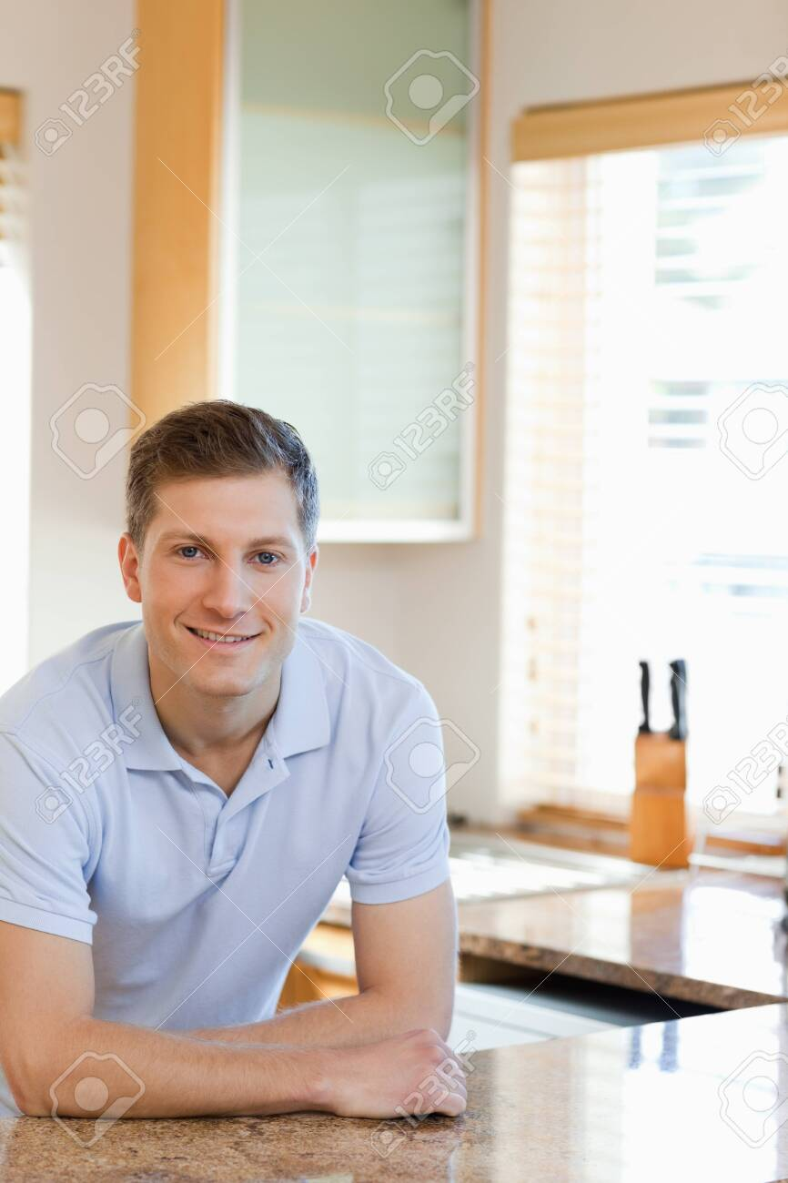 Smiling man leaning against the kitchen counter Stock Photo - 11684947
