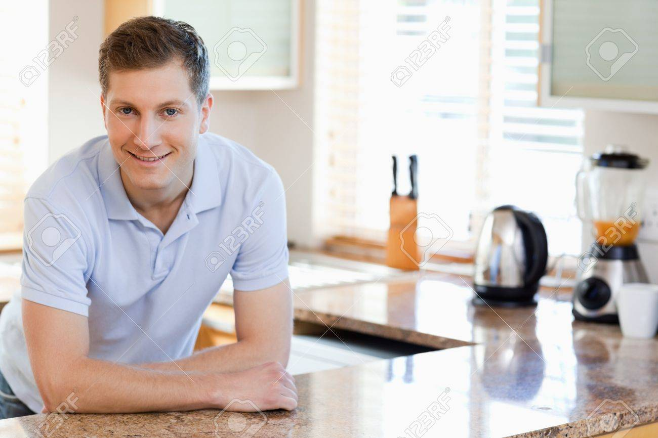 Smiling male leaning against the kitchen counter Stock Photo - 11685203