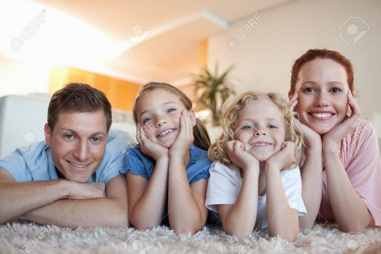 Cheerful smiling family on the carpet Stock Photo - 11682940
