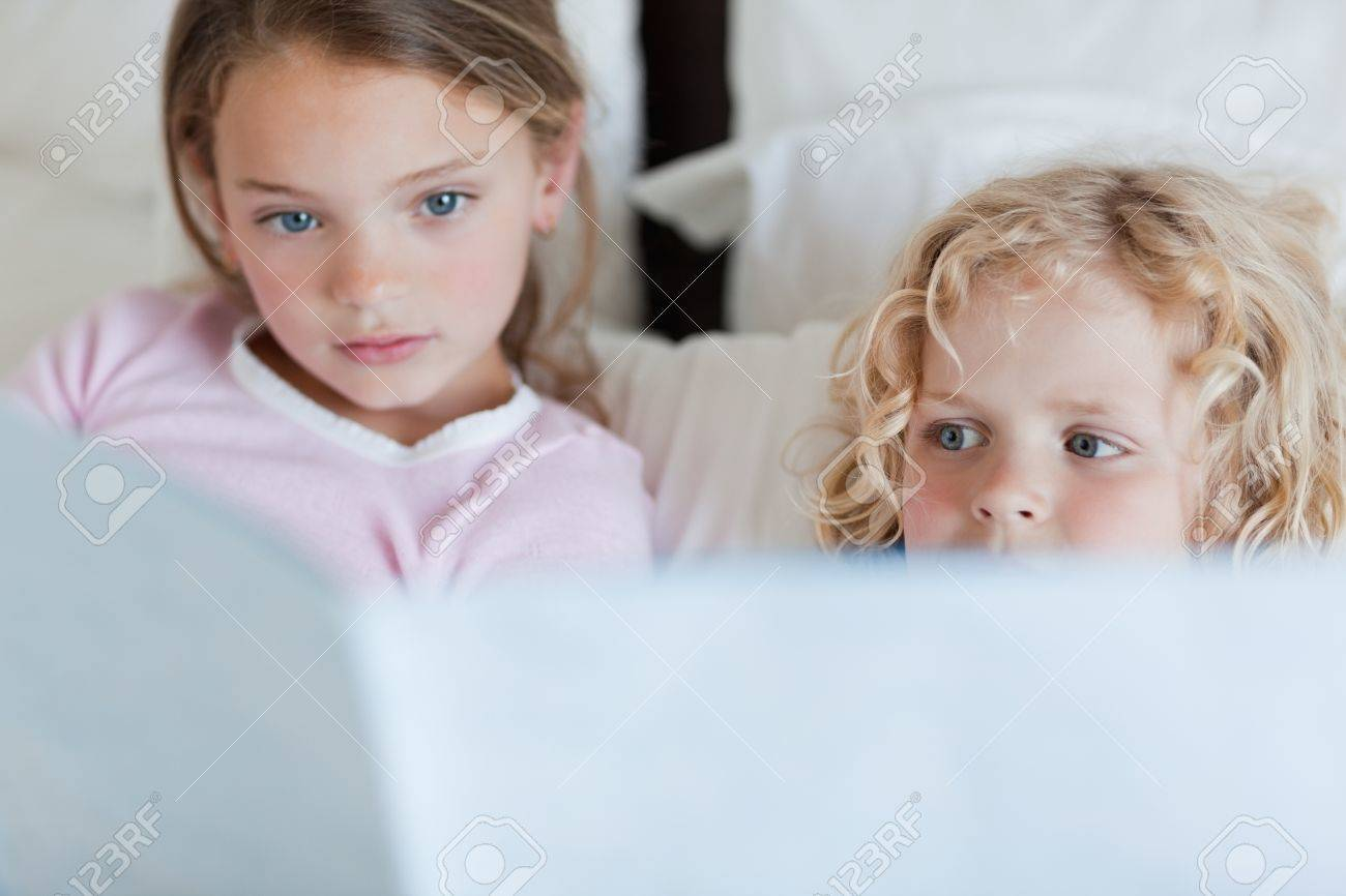 Siblings reading bed time story together Stock Photo - 11685073
