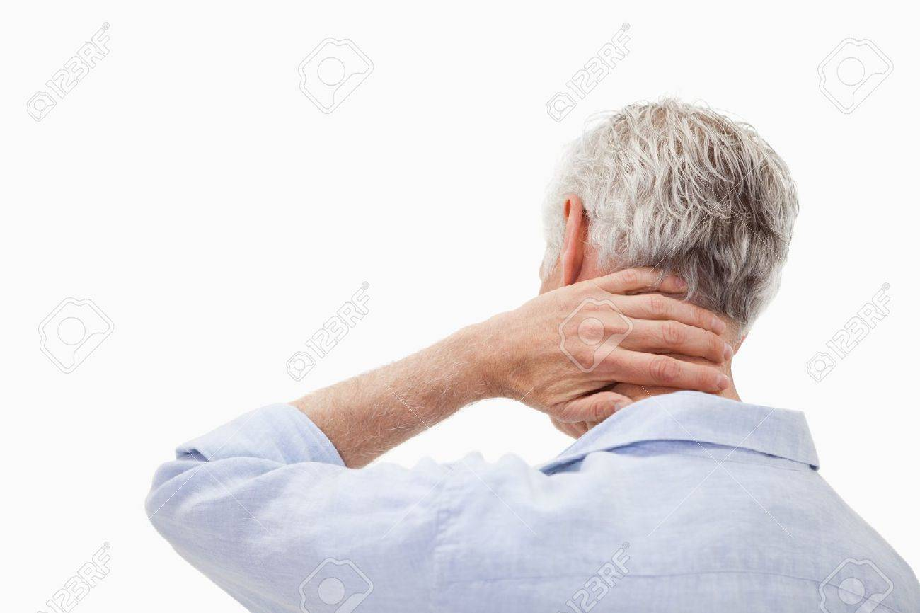 Man having a neck pain against a white background Stock Photo - 11686976