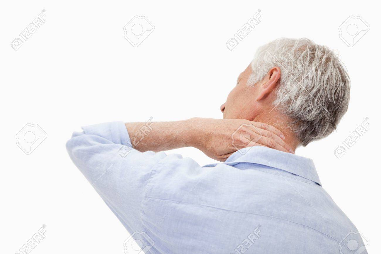 Mature man having a neck pain against a white background Stock Photo - 11686865