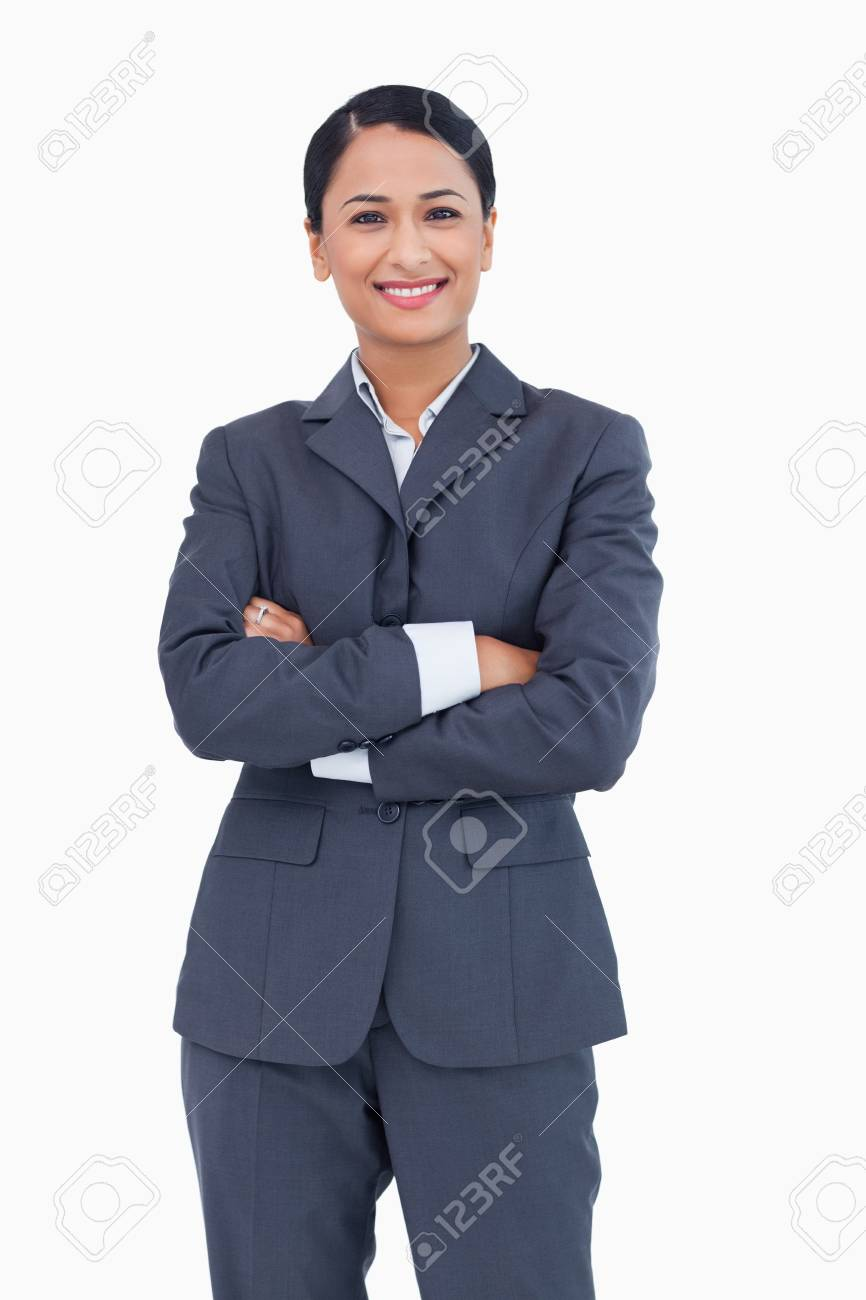 Smiling businesswoman with folded arms against a white background Stock Photo - 13607246