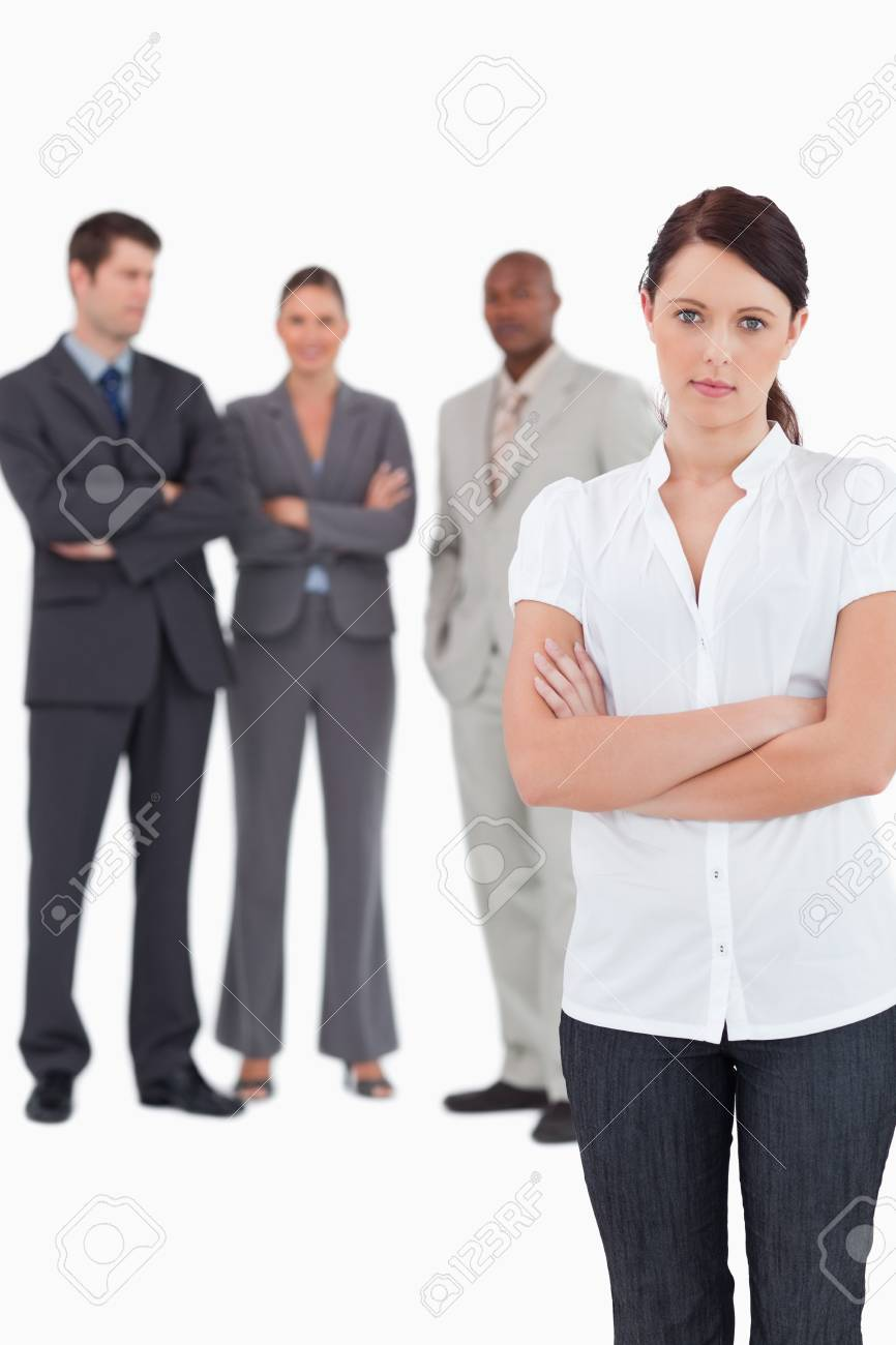 Tradeswoman with arms folded and three colleagues behind her against a white background Stock Photo - 13608652