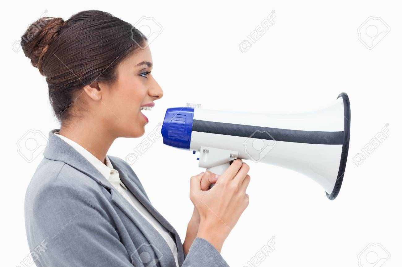 Side view of saleswoman using megaphone against a white background Stock Photo - 13606712