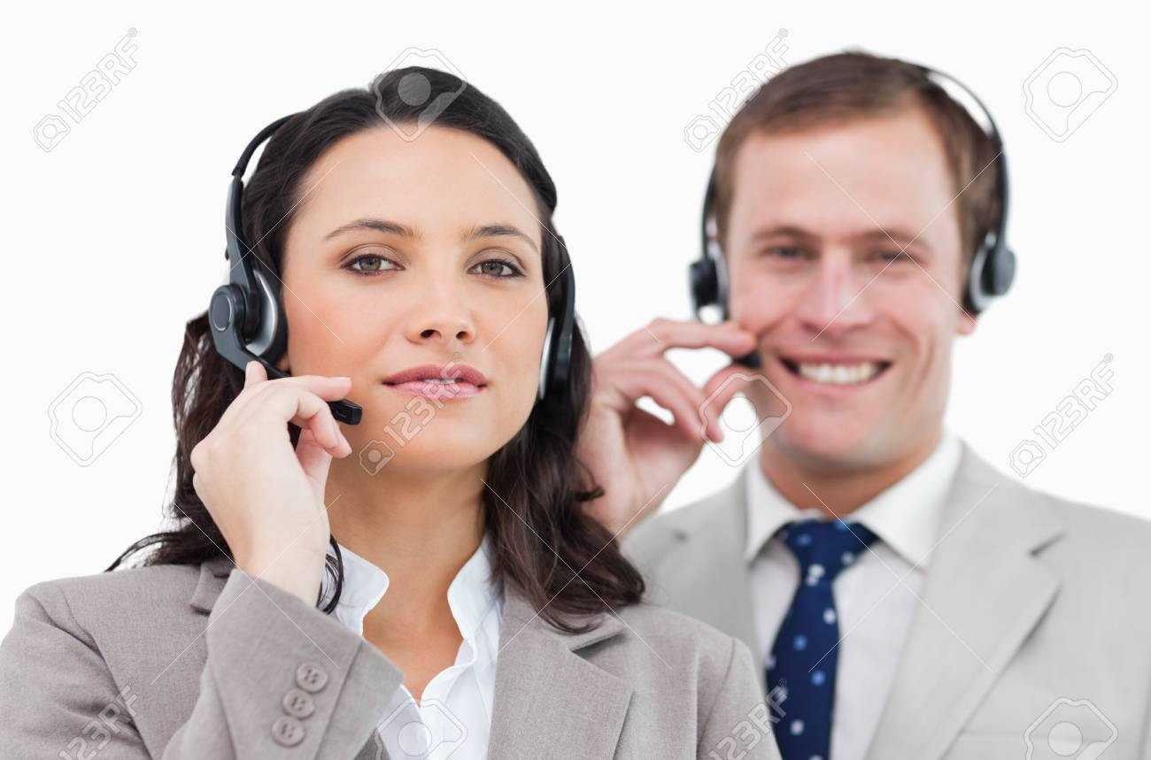 Call center team with their headsets against a white background Stock Photo - 13603514
