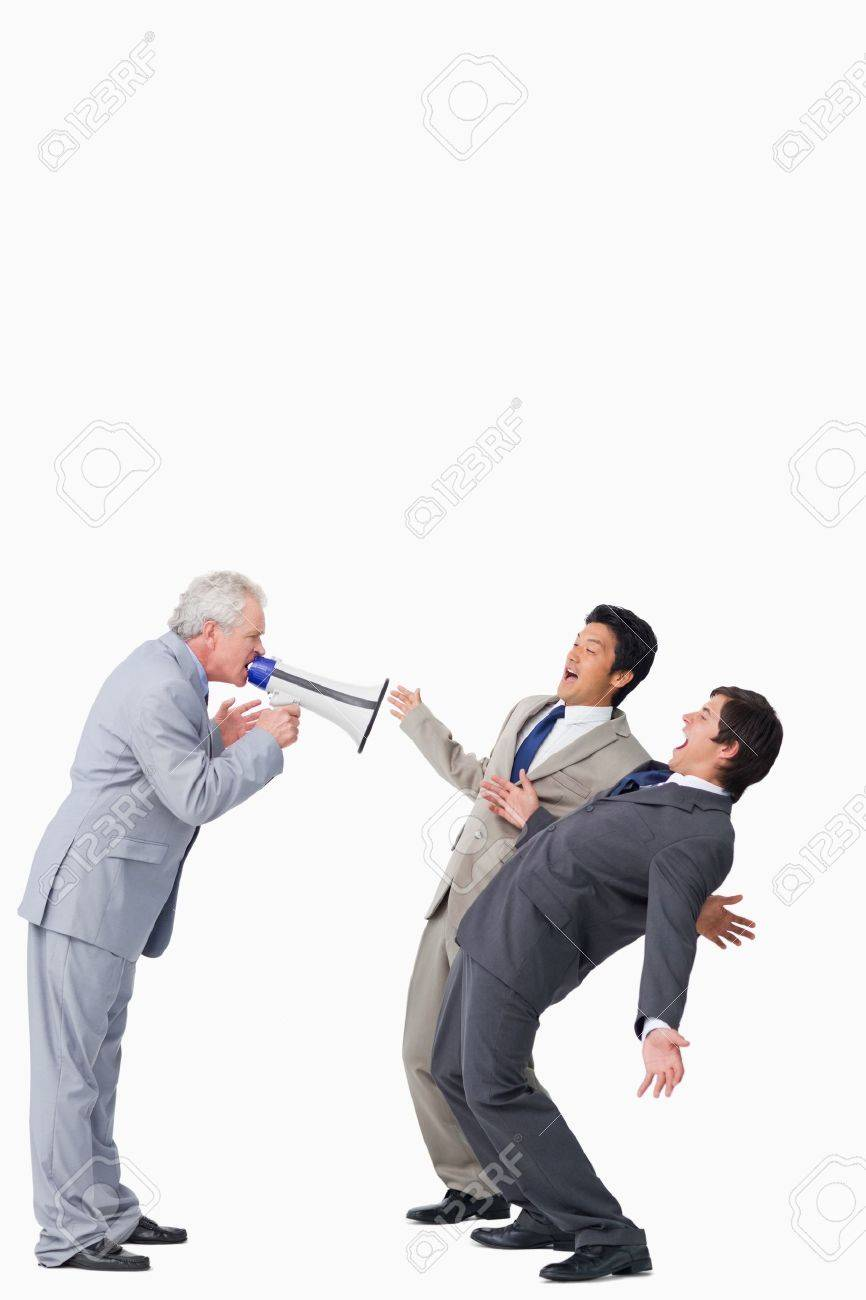 Mature salesman with megaphone yelling at his employees against a white background Stock Photo - 13601330