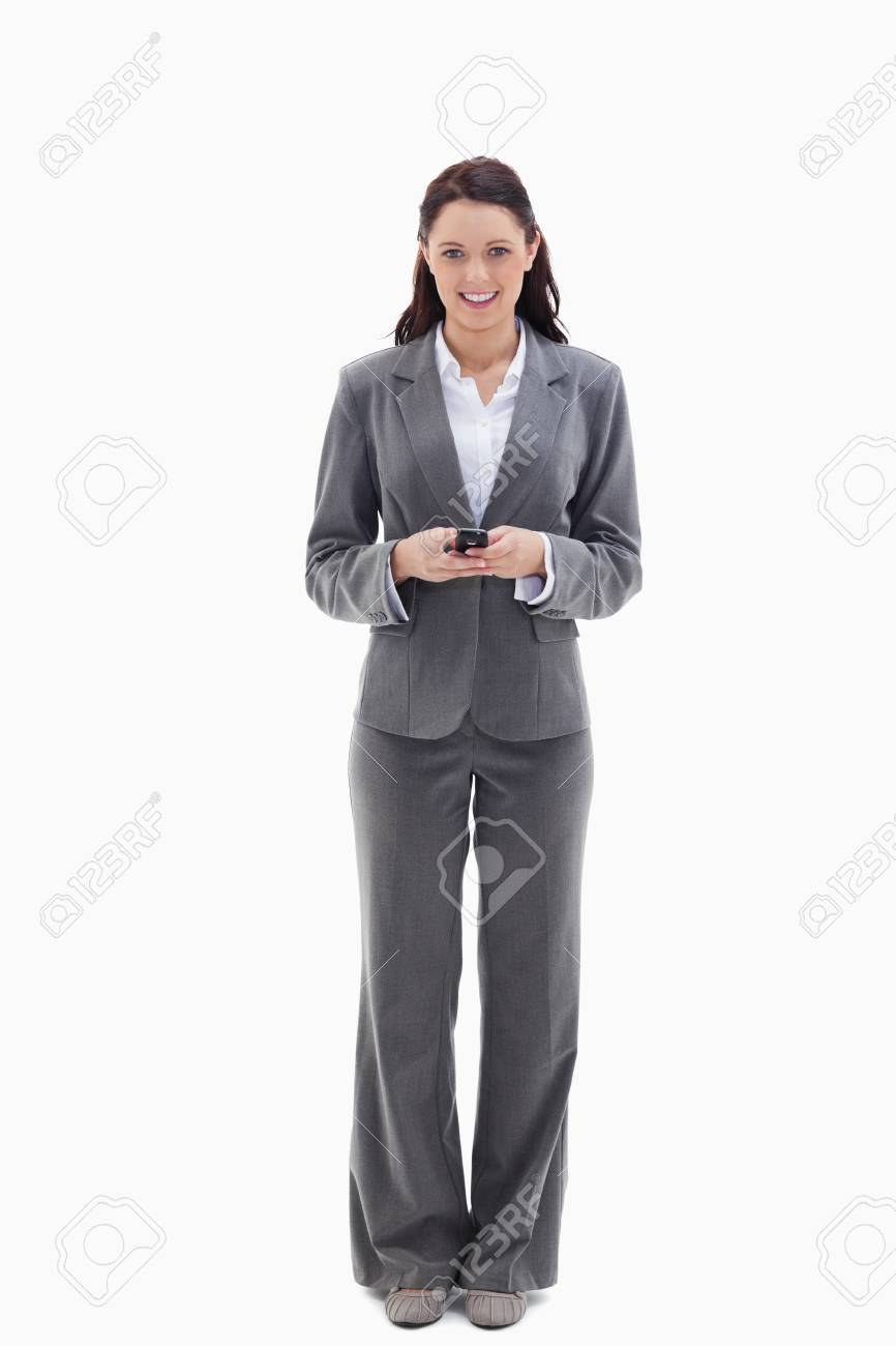 Businesswoman smiling while holding her mobile against white background Stock Photo - 13603653