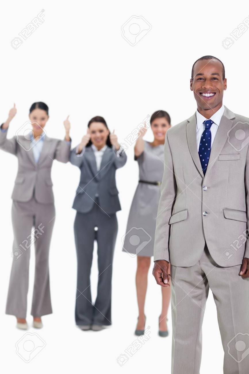 Happy businessman with three approving co-workers in background with thumbs up Stock Photo - 13610185