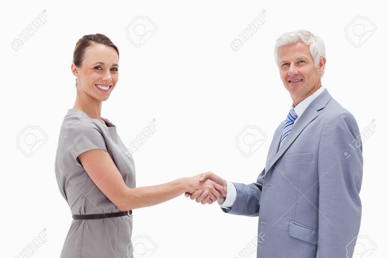 Close-up of a white hair man face to face and shaking hands with a woman against white background Stock Photo - 13605881