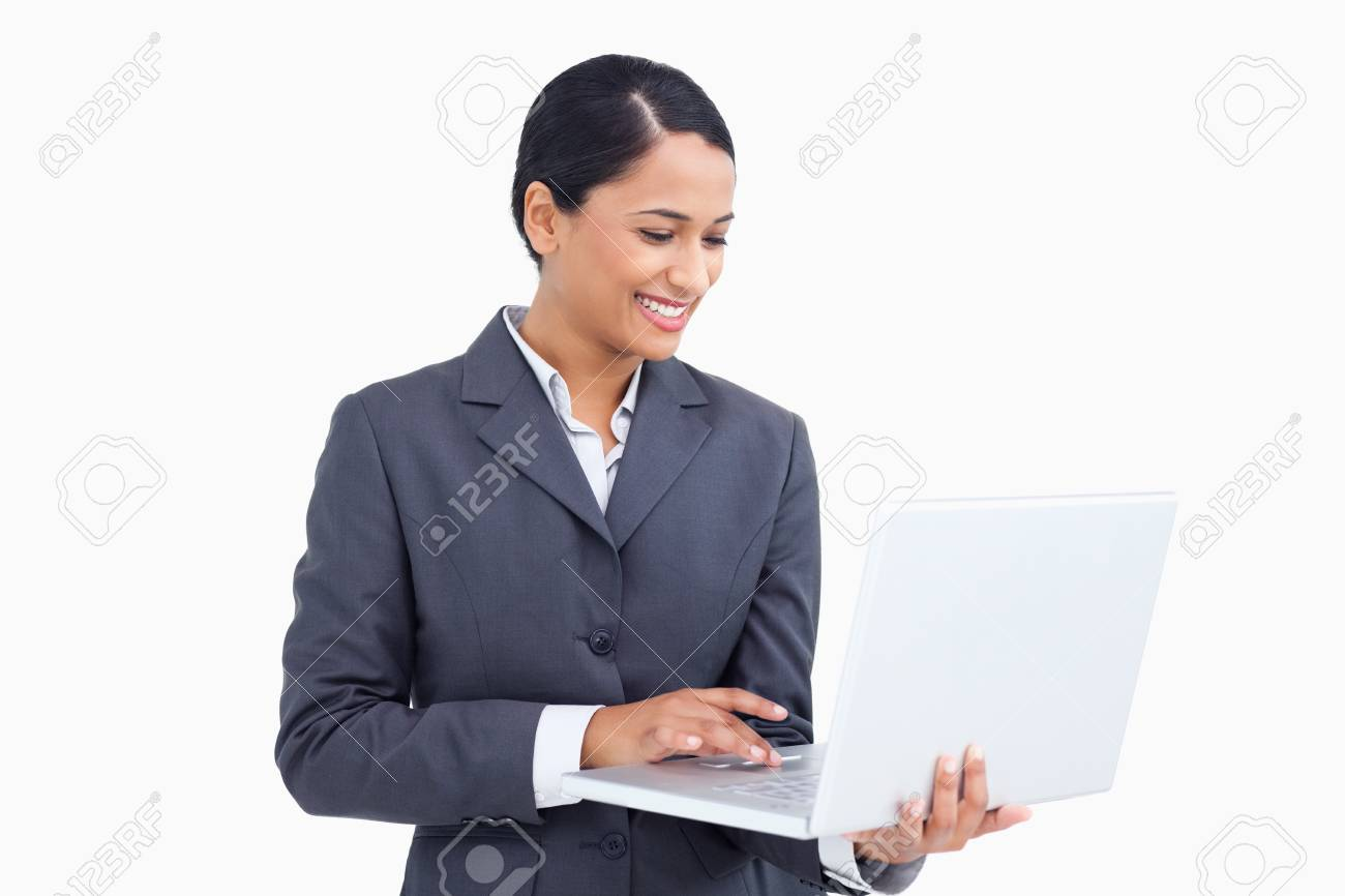 Close up of smiling saleswoman using her laptop against a white background Stock Photo - 13650208