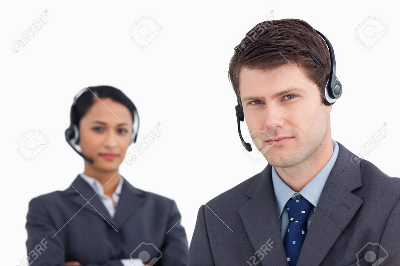Close up of serious looking call center agents against a white background Stock Photo - 13658031