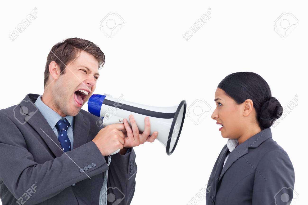Close up of salesman with megaphone yelling at colleague against a white background Stock Photo - 18681619
