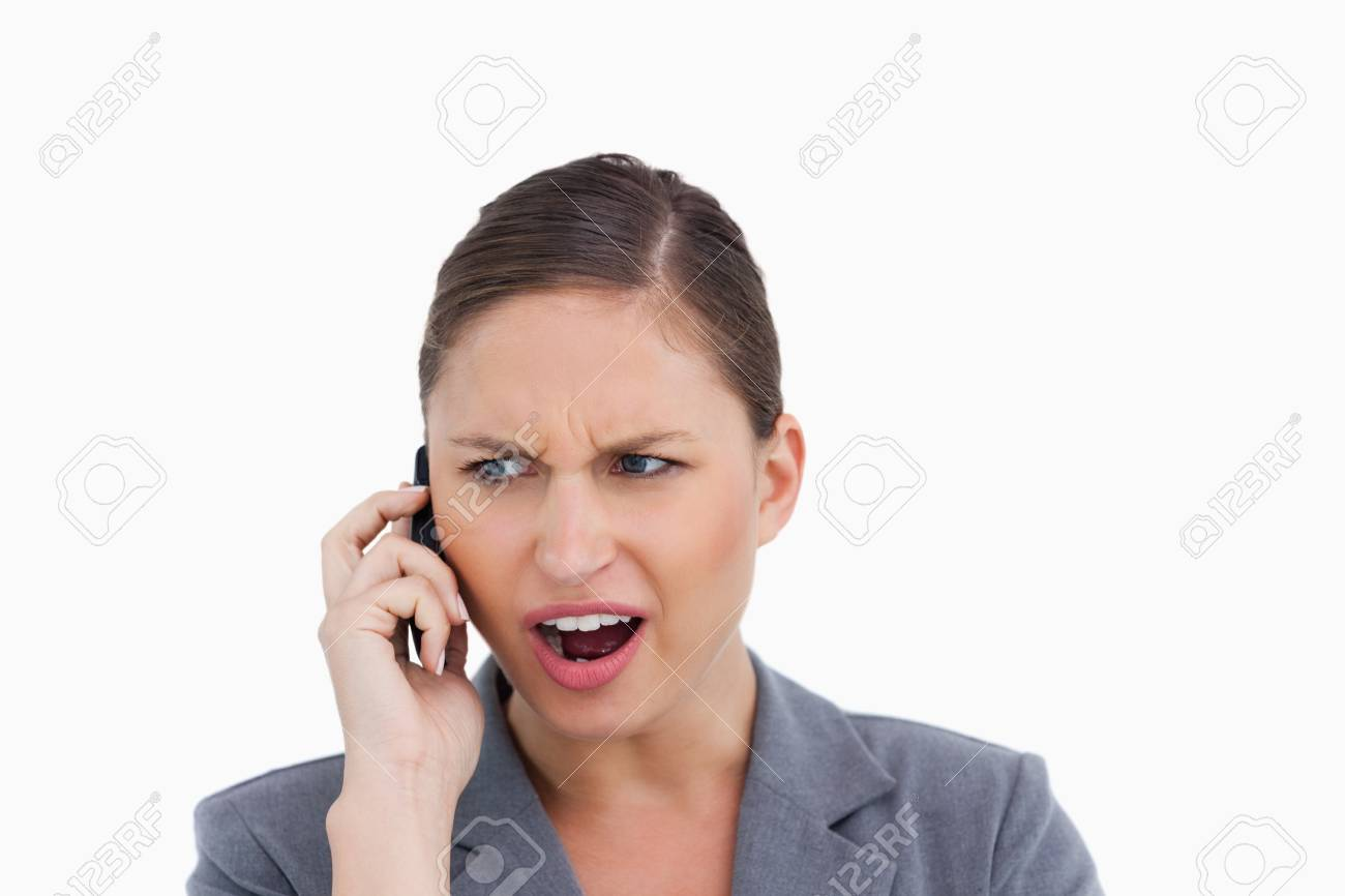 Close up of angry tradeswoman yelling at caller against a white background Stock Photo - 13653151
