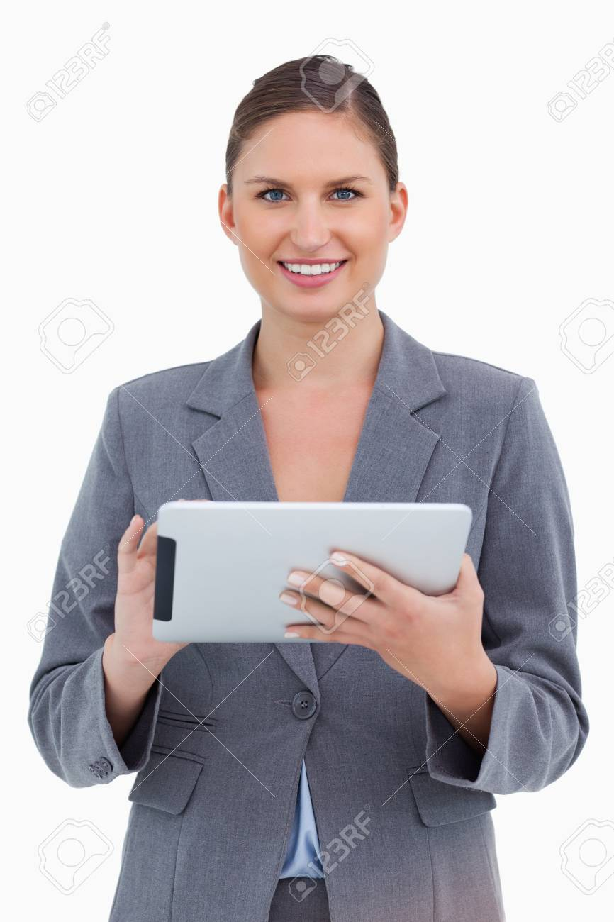 Smiling tradeswoman with her touchscreen computer against a white background Stock Photo - 13675375