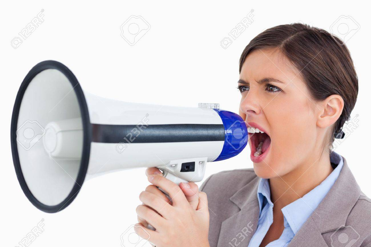 Close up of female entrepreneur yelling through megaphone against a white background Stock Photo - 13658789