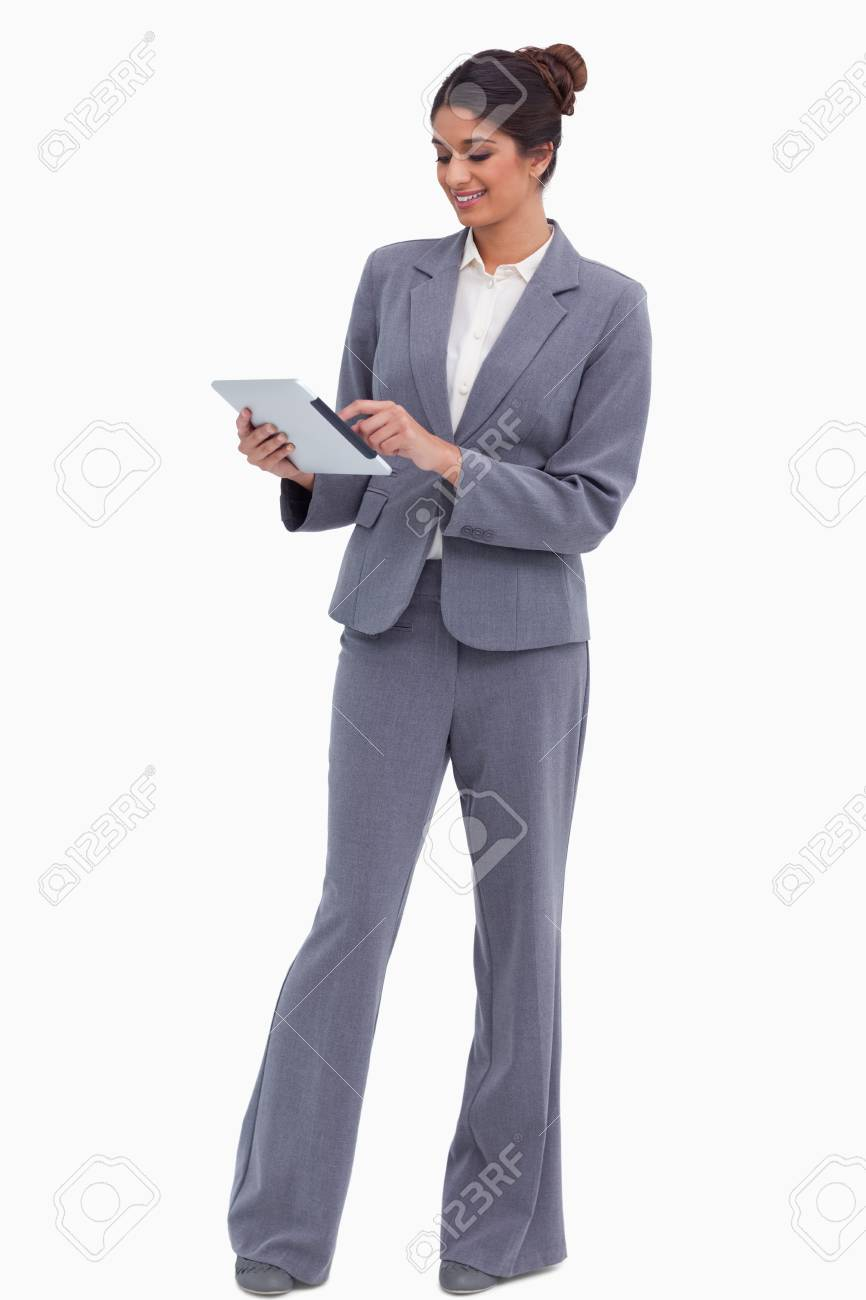Smiling female entrepreneur working on her tablet computer against a white background Stock Photo - 13653215