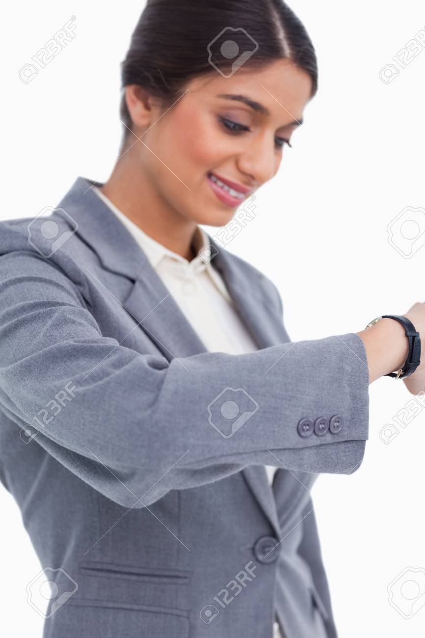 Close up of female entrepreneur looking at watch against a white background Stock Photo - 13653749