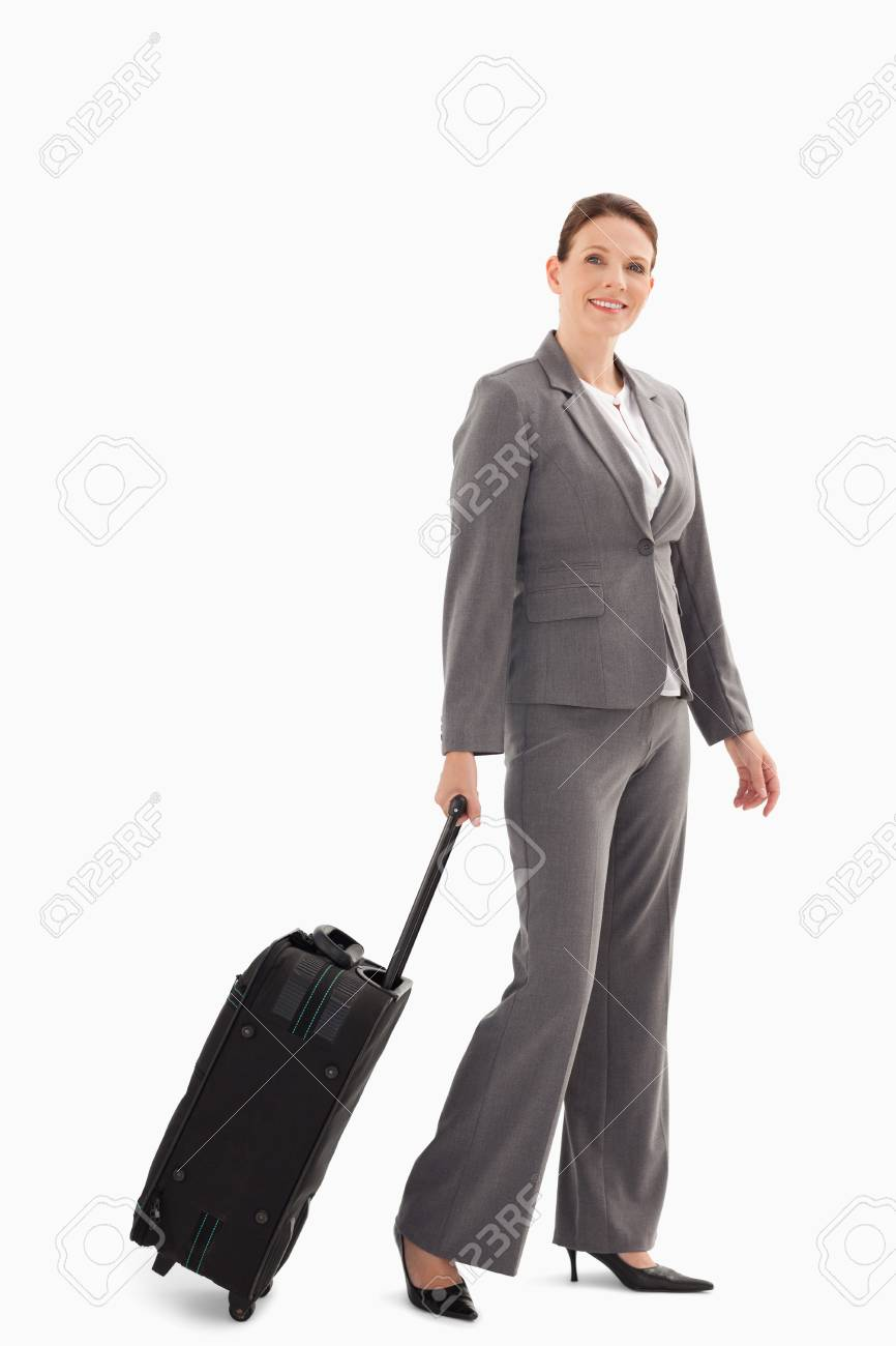 A businesswoman is walking with a suitcase Stock Photo - 13674388