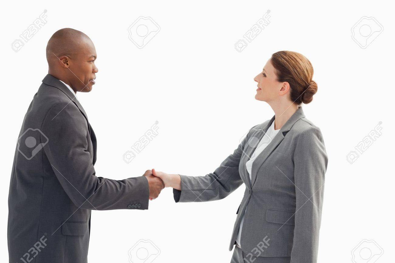 A businessman is shaking a businesswoman's hand Stock Photo - 13674168