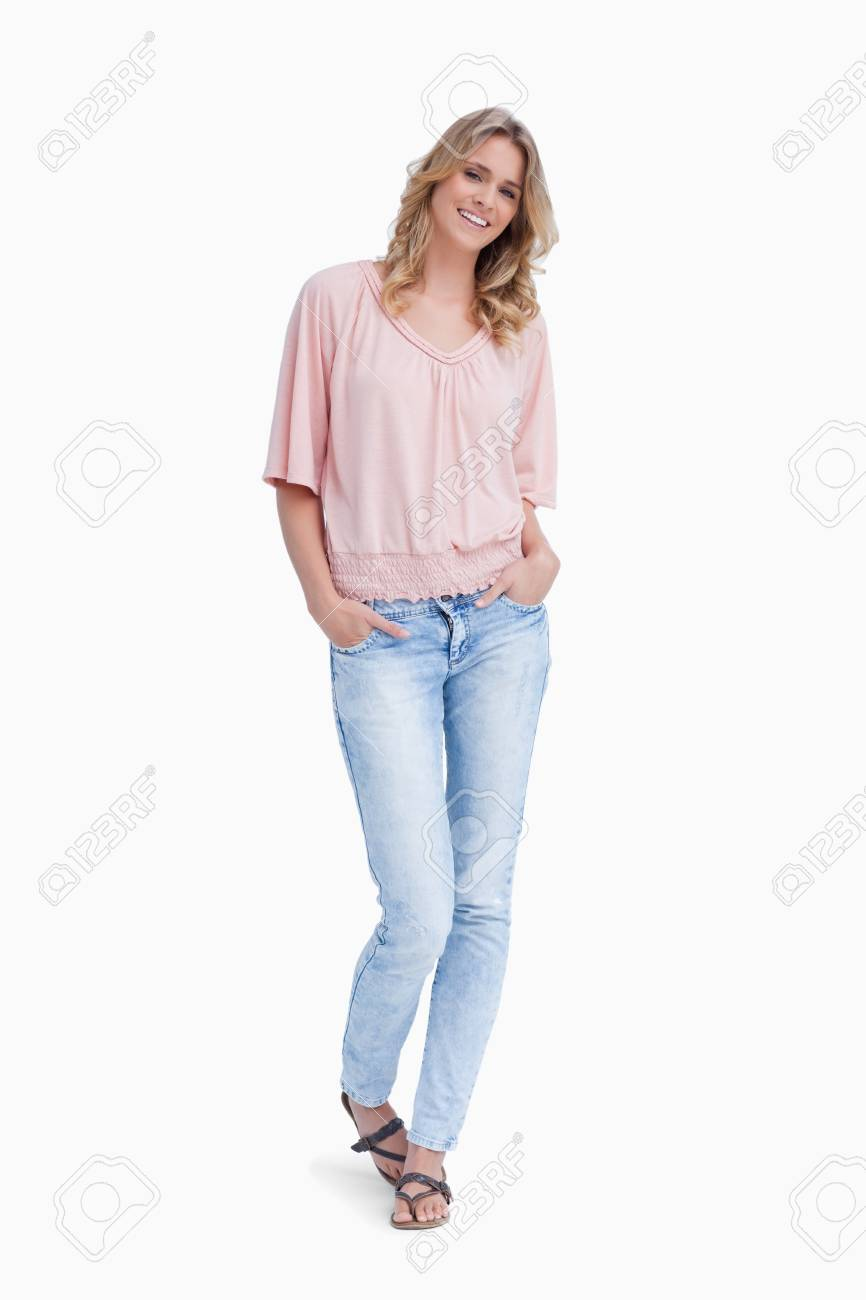 A woman is standing with her hands in her pockets against a white background Stock Photo - 13674745
