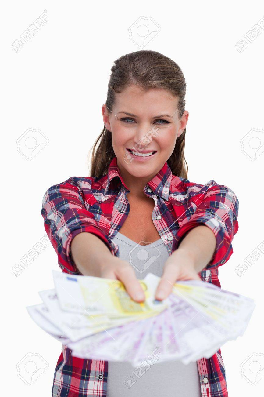 Portrait of a rich woman showing bank notes against a white background Stock Photo - 13683915