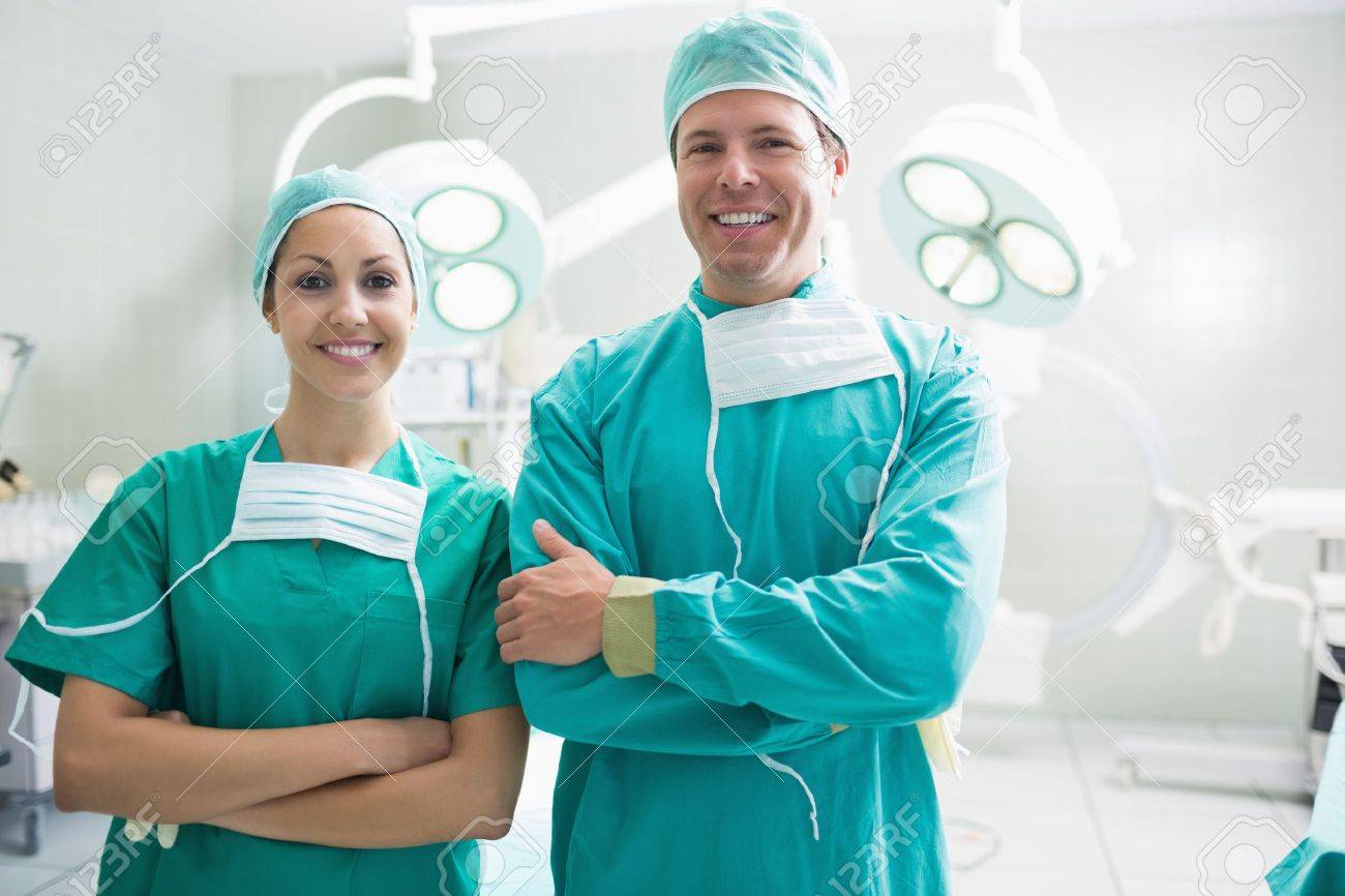 Smiling surgeons looking at camera in an operation theatre Stock Photo - 15551474