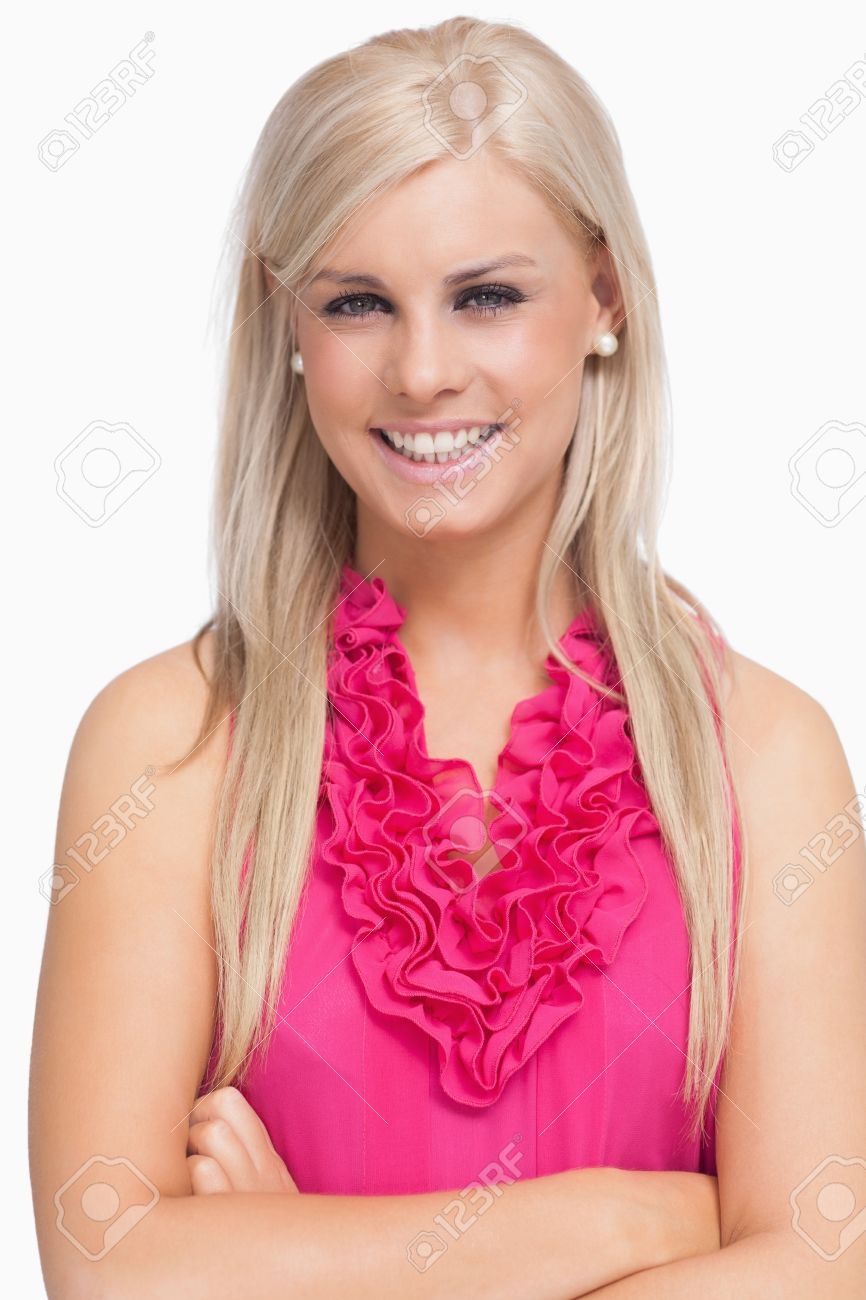 Smiling blonde arms crossed against white background - 15551497