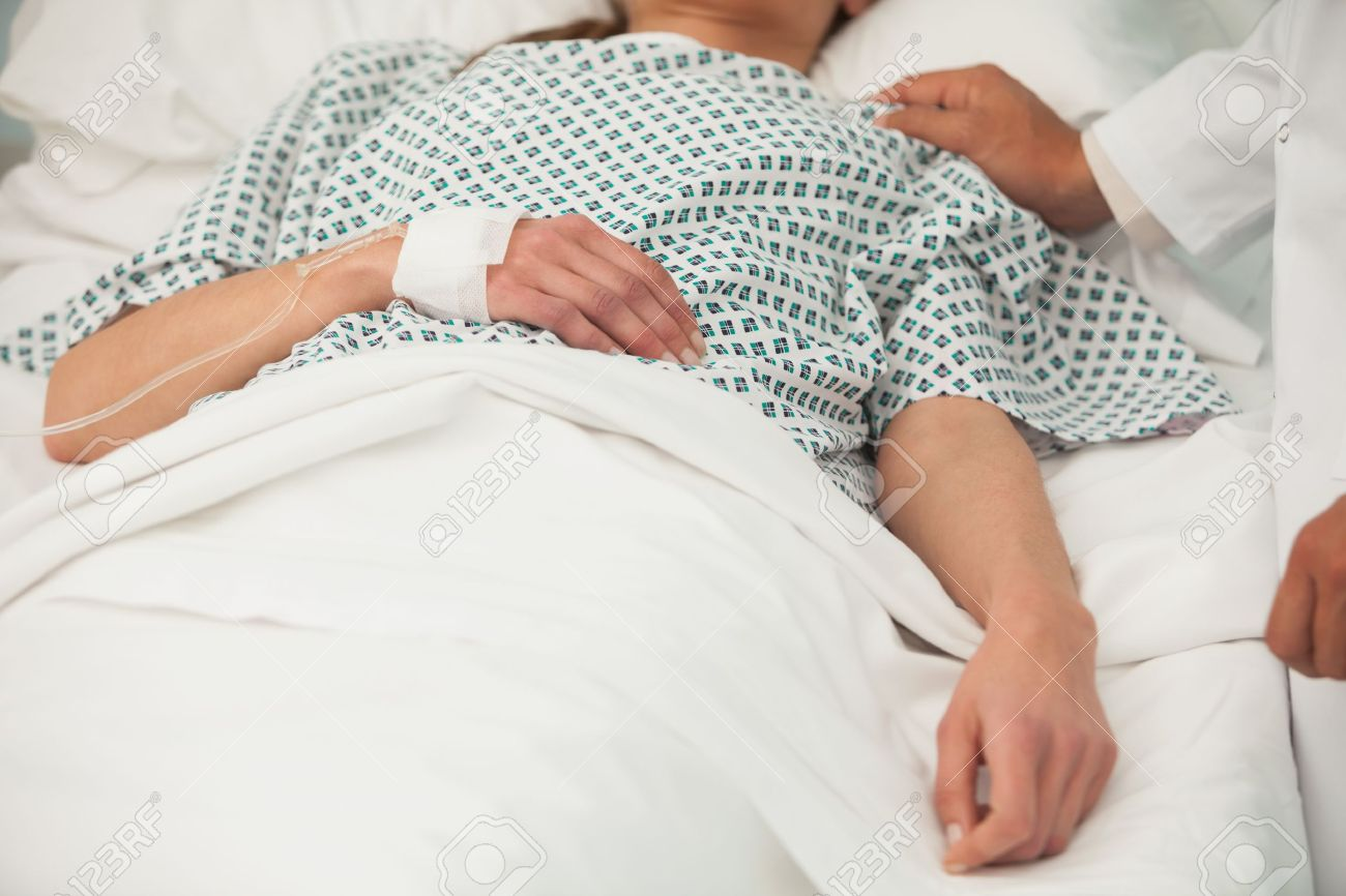 Old sick lady lying in hospital bed Stock Photo - 15590550