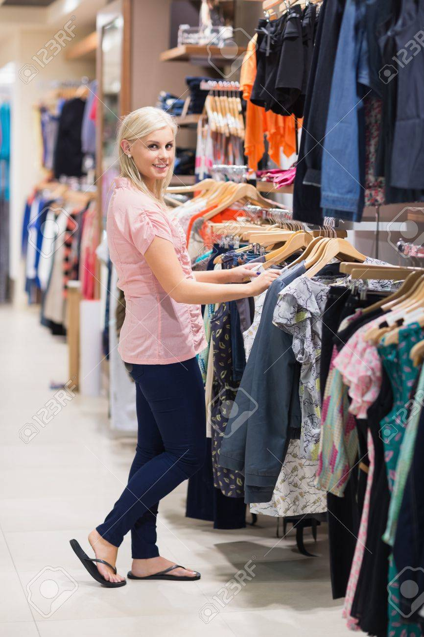 Woman is looking at clothes searching and smiling Stock Photo - 15593040