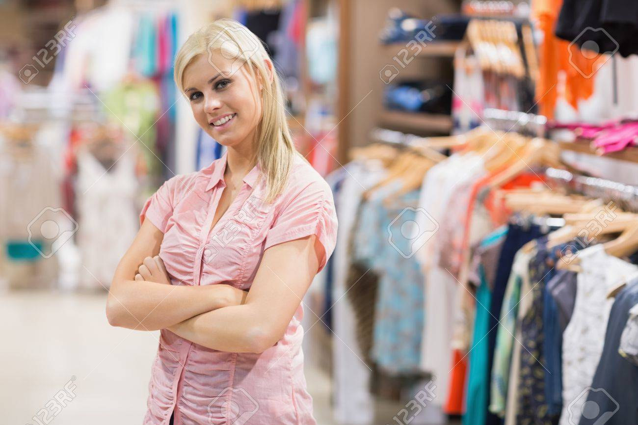 Woman standing in shop smiling with arms crossed Stock Photo - 15593005